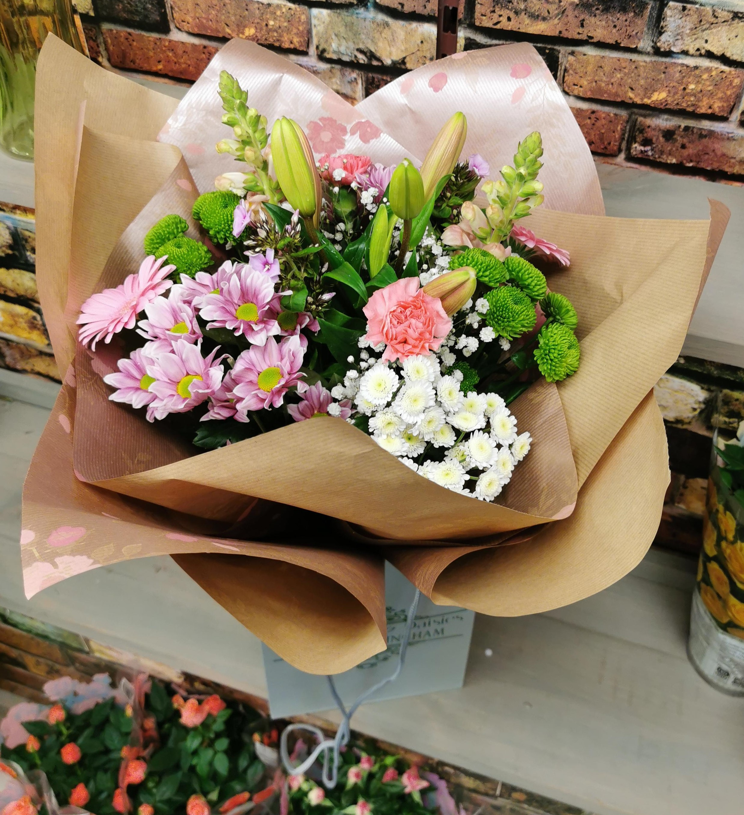 Florist's choice hand tied Pink shades